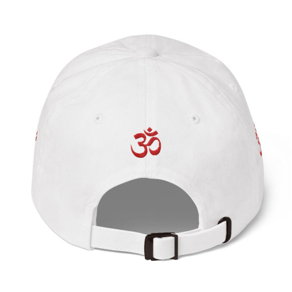 white baseball cap with embroidered red Om sign