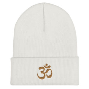 white winter hat with beautifully embroidered golden Om sign