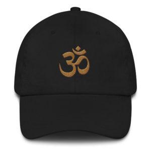 black baseball cap with embroidered golden Om sign