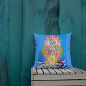 Blue pillow in front of the green wall with picture of Vishu imprinted on it. Vishnu has snakes and sun behind him and is holding a large mace, lotus flower, chakra (discus) and a conchshell in his four hands.