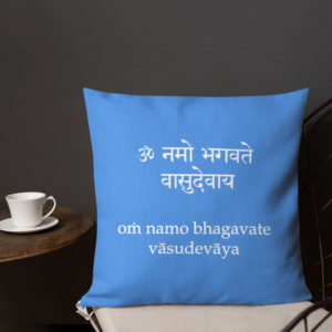 blue pillow near the coffee table with Vishnu mantra Om Namo Bhagavate Vasudevaya both in sanskrit and transliterated with latin characters imprinted on it